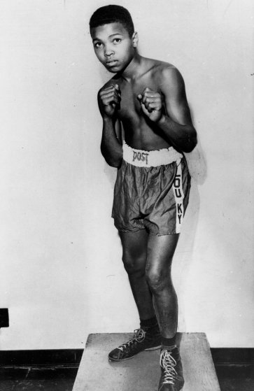 FILE - In this 1954 file photo, boxer Cassius Clay is shown. Long before his dazzling footwork and punching prowess made him a three-time world heavyweight boxing champion known as Muhammad Ali, a young Cassius Clay honed his skills by sparring with neighborhood friends and running alongside the bus on the way to school. Ali turns 70 on Jan. 17, 2012. (AP Photo/File)