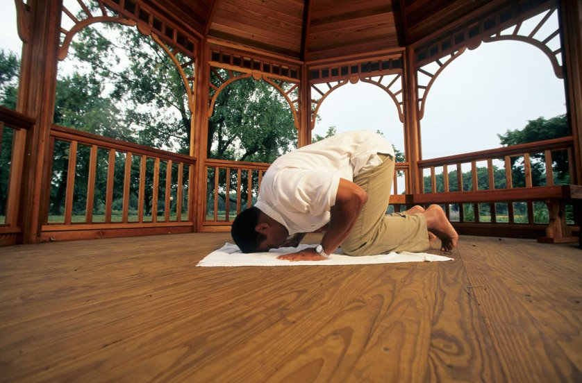 Boxing: Portrait of Muhammad Ali praying on a gazebo at his farm. Berrien Springs, MI 9/10/1996 CREDIT: Walter Iooss Jr. (Photo by Walter Iooss Jr. /Sports Illustrated/Getty Images) (Set Number: X51351 TK1 )