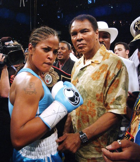 Boxing legend Muhammad Ali steps down to the ring on June 11, 2005, in Washington, DC after congratulated his daughter Laila who won with a 3 round TKO against Erin Toughill for the WBC/WIBA Super Middleweight Championship Bout. (Pictured:Muhammad Ali,Laila Ali) Photo by Olivier Douliery/ABACA     muhammad ali attends the fight of his daughter laila .washington  muhammad ali attends the fight of his daughter laila .washington s usa world rights