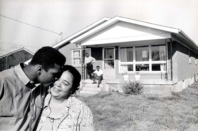 BD3BTH MUHAMMAD ALI  about 1965 with mother Odessa at the family home in Louisville, Kentucky.. Father Cassius & brother Rudolph behind