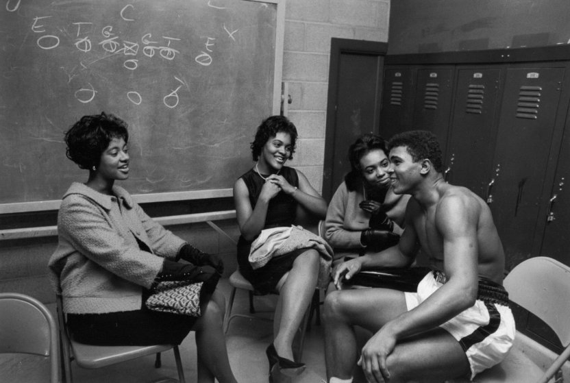 October 7, 1961, Louisville, Kentucky, USA: Muhammed Ali, future world heavyweight champion and legendary boxer, was still fighting under his birth name Cassius Clay when he knocked out Alex Miteff in the sixth round. In the arena's basement before the fight, Ali had a mixture of female admirers and relatives. His brother Rudy Clay, later known as Rahman Ali, was also on hand as Ali's official gofer.///Cassius Clay (Muhammad Ali) with fans after fight. Credit: Art Shay / Polaris